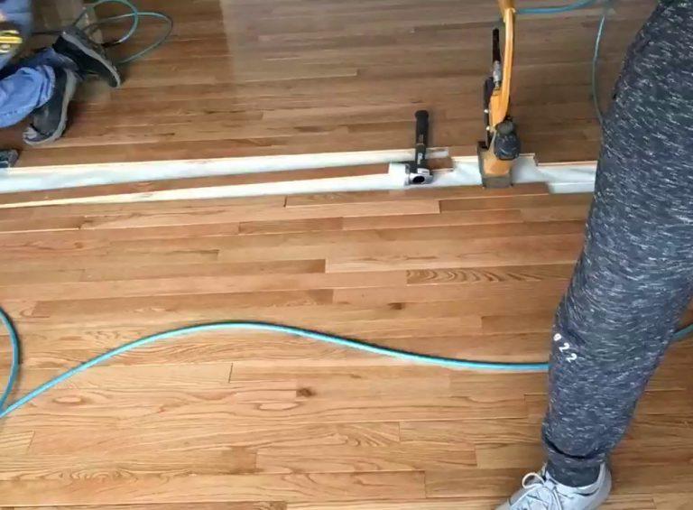 company installing hardwood flooring in home