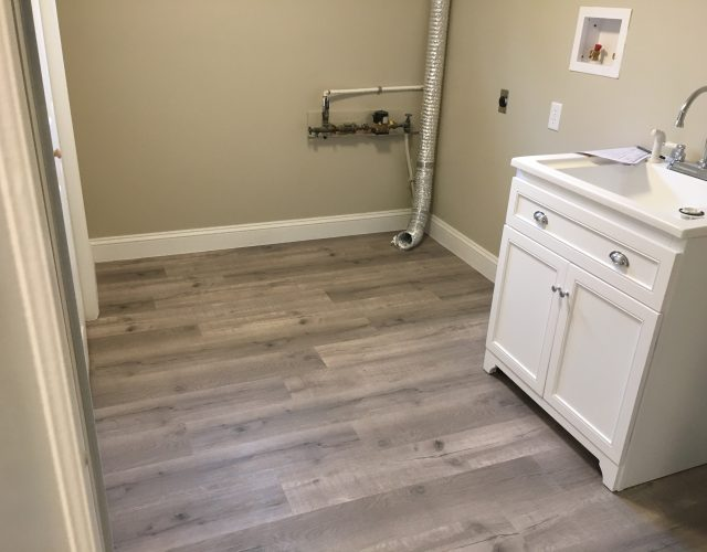 newly installed hardwood floor in bathroom