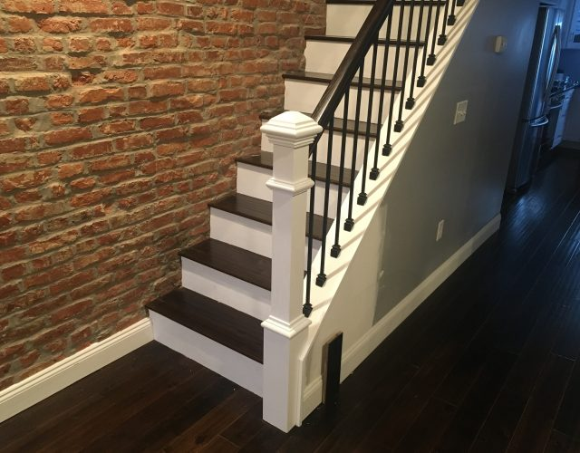 half wood and half white painted house staircase