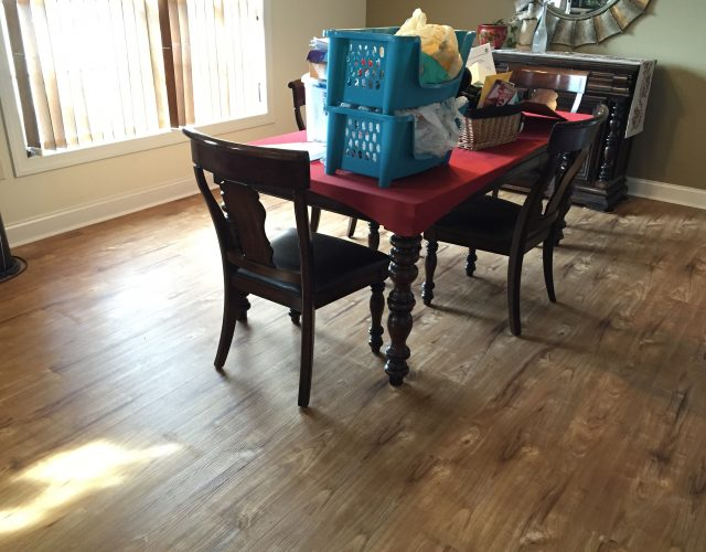 light hardwood flooring in dining room