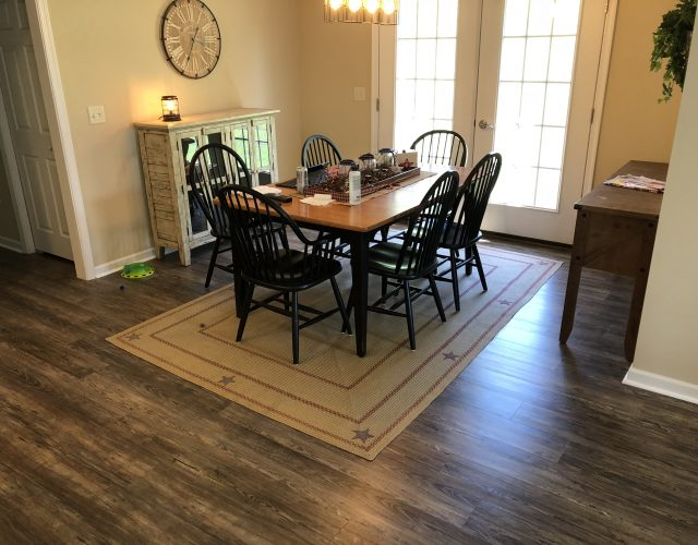 hardwood flooring in furnished dining room