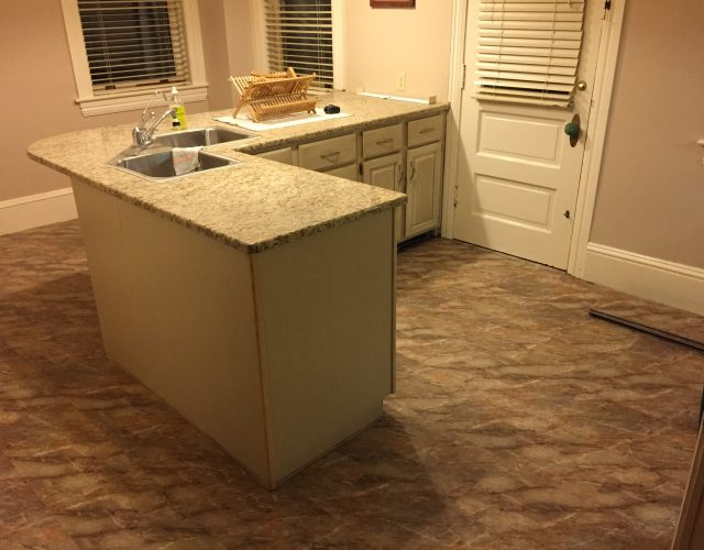 engineered wood and vinyl flooring in kitchen