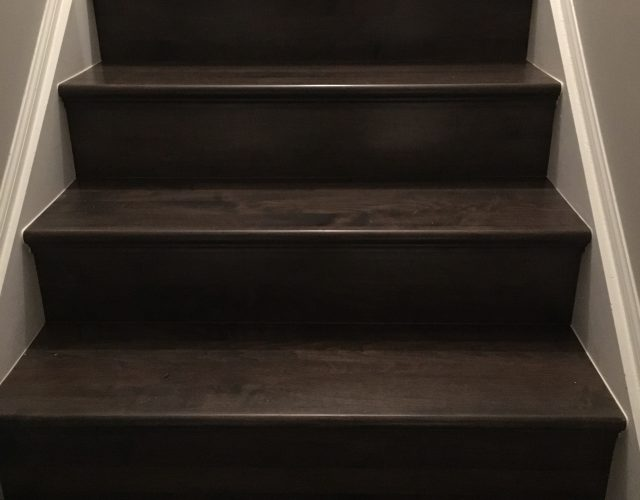 close up of dark hardwood staircase