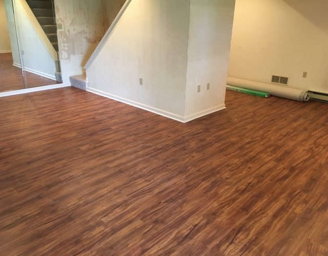 dark engineered hardwood floors in room