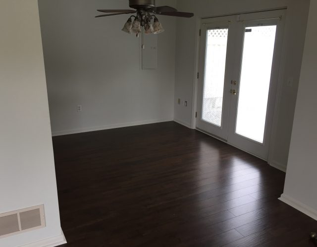chestnut hardwood flooring in unfurnished room