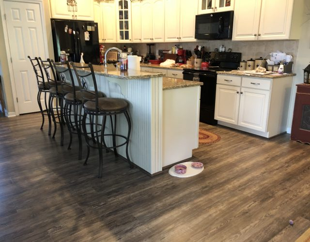 completed hardwood flooring in kitchen