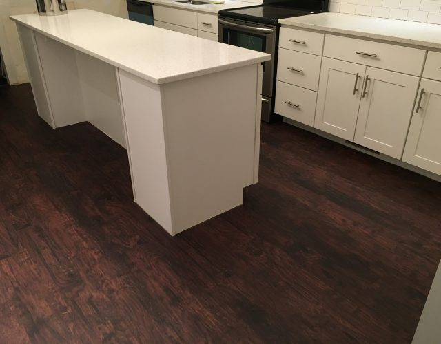 dark laminated hardwood kitchen floor