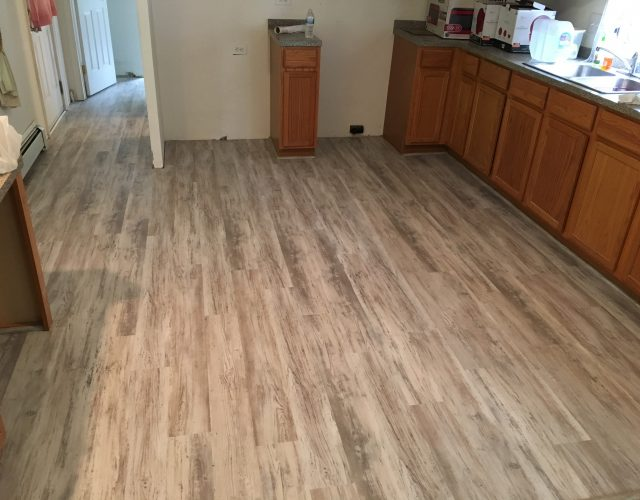 light engineered wood flooring on kitchen