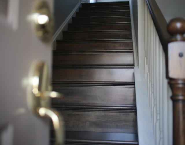 dark wood laminate staircase in home