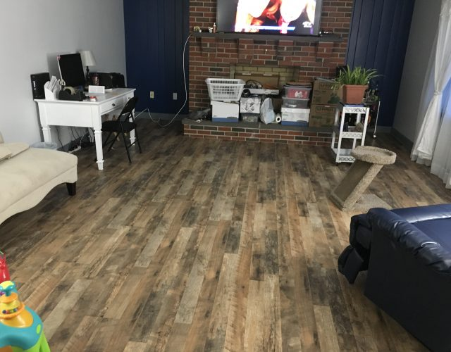 hardwood laminate floor in furnished living room