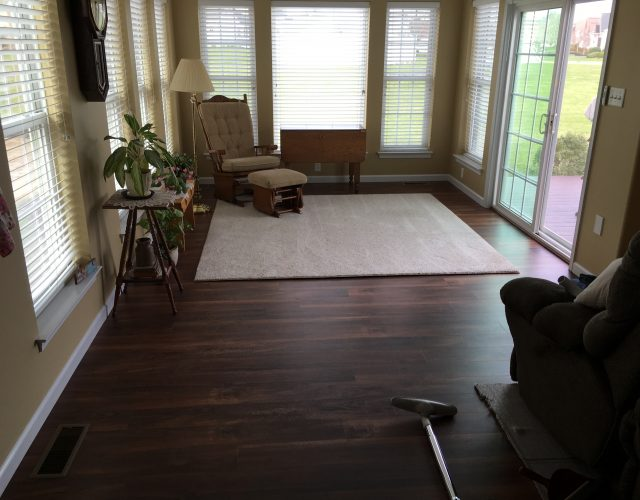 dark wood flooring in sunroom