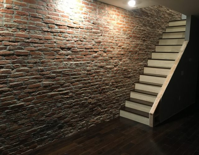 wooden staircase in basement